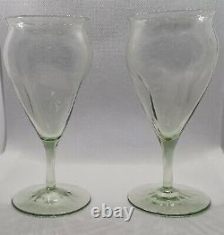 Pair of James Powell & Sons poppy glasses in dark green